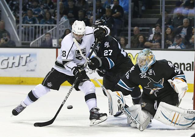 San Jose Sharks goalie Alex Stalock (32) blocks a goal attempt by Los Angeles Kings center Jarret Stoll (28) during the second period of Game 4 of an NHL hockey first-round playoff series in San Jose, Calif., Saturday, April 26, 2014. (AP Photo/Tony Avelar)