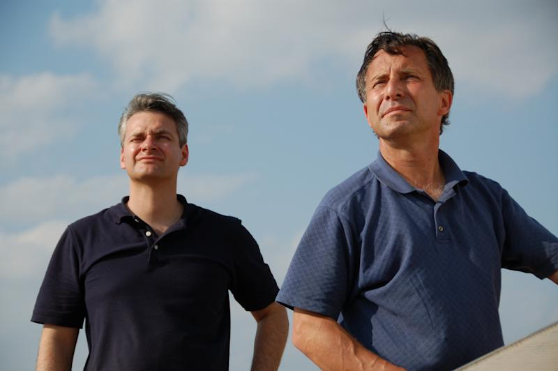 This undated photo provided by The Discovery Channel shows Carl Young, left, and Tim Samaras watching the sky. Jim Samaras said Sunday, June 2, 2013, that his brother storm chaser Tim Samaras was killed along with Tim's son, Paul Samaras, and another chaser, Carl Young,  on Friday, May 31, 2013 in Oklahoma City. The National Weather Service's Storm Prediction Center in Norman, Okla., said the men were involved in tornado research.( AP Photo/Discovery Channel) MANDATORY CREDIT