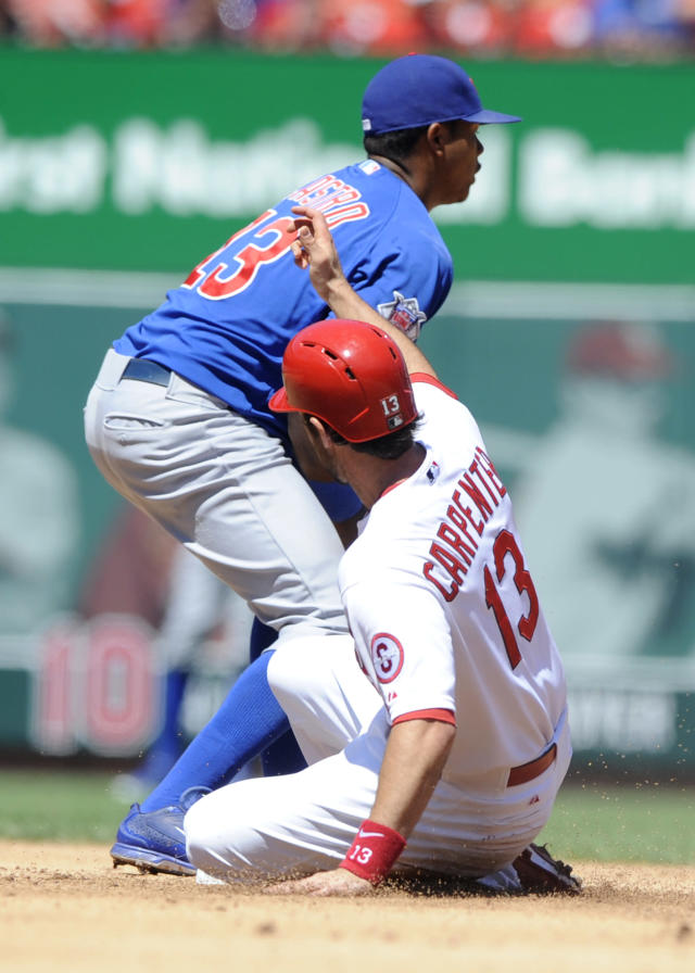 St. Louis Cardinals' Matt Carpenter, bottom, slides into second with a double as Chicago Cubs' Starlin Castro waits for the ball in the third inning in a baseball game on Sunday, Aug. 11, 2013, at Busch Stadium in St. Louis. (AP Photo/Bill Boyce)