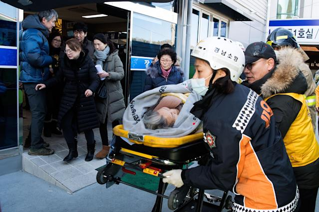 <p>Rescue workers carry a patient on Jan. 26, 2018 in Miryang, South Korea. (Photo: Kookje Shinmun via Getty Images) </p>