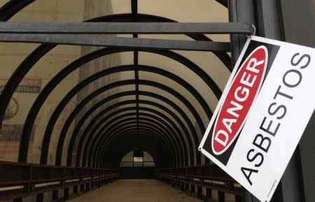 A warning sign is seen on a walkway leading to abandoned Sheraton hotel in downtown Gary, Indiana
