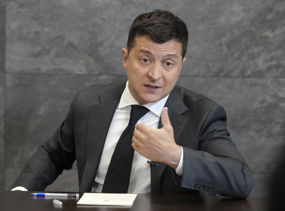 Ukrainian President Volodymyr Zelenskyy gestures while speaking to the media during a news conference in Kyiv, Ukraine, Monday, June 14, 2021. (AP Photo/Efrem Lukatsky)