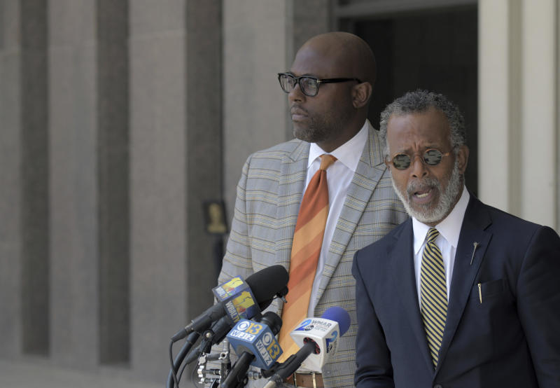 Defense attorneys J. Wyndal Gordon, left, and Warren Brown speak following the life sentence, meted out for 17-year-old Dawnta Harris at Baltimore County Circuit Court Wednesday, Aug. 21, 2019, in Towson, Md. Harris was tried as an adult earlier this year and convicted of felony murder in the slaying of Baltimore County police Officer Amy Caprio. Caprio encountered Harris in May 2018 while responding to a report of a suspicious vehicle. (Karl Merton Ferron/The Baltimore Sun via AP)
