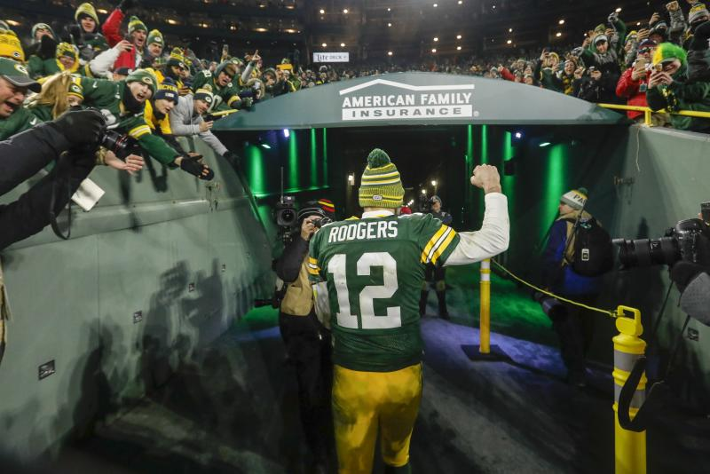 Green Bay Packers' Aaron Rodgers celebrates as he walks off the field after an NFL divisional playoff football game against the Seattle Seahawks Sunday, Jan. 12, 2020, in Green Bay, Wis. The Packers won 28-23 to advance to the NFC Championship. (AP Photo/Mike Roemer)