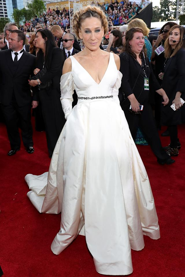 """<p>Go bun or go home! For the Golden Globes, SJP chose a hairstyle that was one part Princess Leia, one part brioche. Asked by NBC's Natalie Morales about whether her unique hairdo was a homage to the late Carrie Fisher, Parker admitted it was merely an accident. """"I didn't mean for that,"""" she said. The <i>Divorce</i> star went on to call her Vera Wang dress """"a complete and utter delight"""" — which it was, compared to her hair. (Photo: Neilson Barnard/NBCUniversal/NBCU Photo Bank via Getty Images) </p>"""