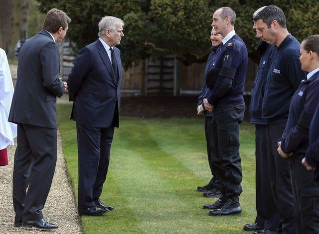 The Duke of York (second left) spoke with Crown Estate staff in Windsor (Steve Parsons/PA)