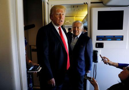 U.S. President Donald Trump speaks to reporters with New England Patriots owner Robert Kraft at his side aboard Air Force One as he departs West Palm Beach, Florida, U.S., to return to Washington March 19, 2017.  REUTERS/Kevin Lamarque