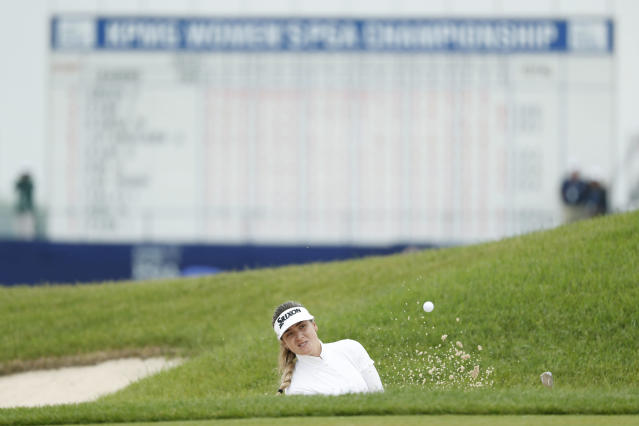 Hannah Green, of Australia, hits out of a bunker on the 18th green during the final round of the KPMG Women's PGA Championship golf tournament, Sunday, June 23, 2019, in Chaska, Minn. (AP Photo/Charlie Neibergall)