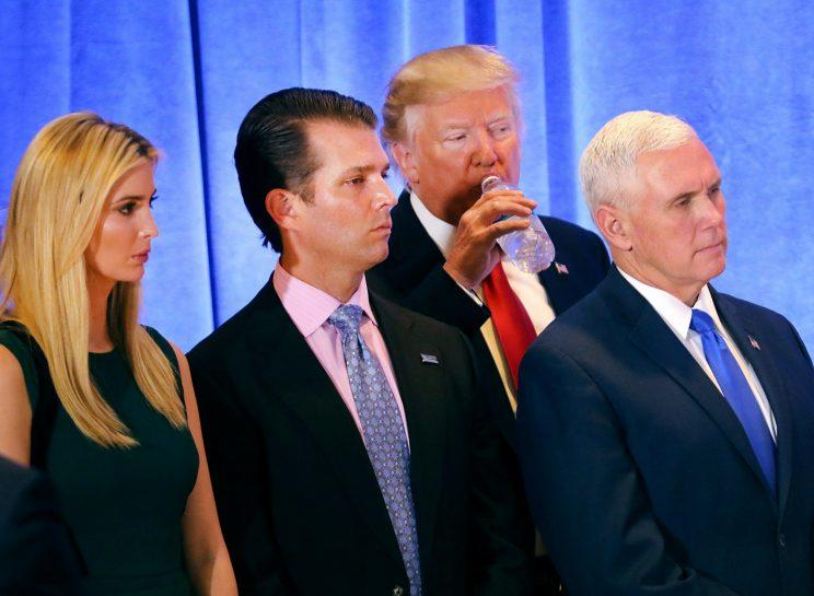 Ivanka Trump, left, with her brother, Donald Trump Jr., father, and Vice President-elect Mike Pence during Wednesday's press conference. (Photo: Getty Images)