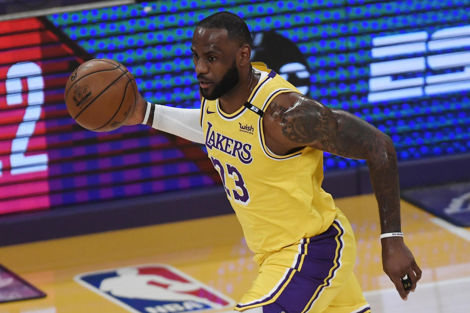 LeBron James #23 of the Los Angeles Lakers dribbles during the first half of an NBA Tournament Play-In game against the Golden State Warriors at Staples Center on May 19, 2021 in Los Angeles, California. NOTE TO USER: User expressly acknowledges and agrees that, by downloading and or using this photograph, User is consenting to the terms and conditions of the Getty Images License Agreement. (Photo by Kevork Djansezian/Getty Images)