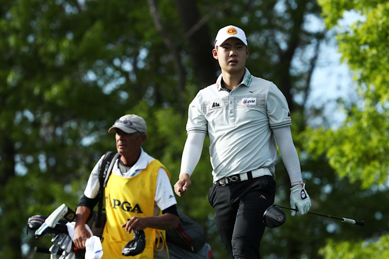 FARMINGDALE, NEW YORK - MAY 18: Jazz Janewattananond of Thailand walks from the 18th tee during the third round of the 2019 PGA Championship at the Bethpage Black course on May 18, 2019 in Farmingdale, New York. (Photo by Jamie Squire/Getty Images)