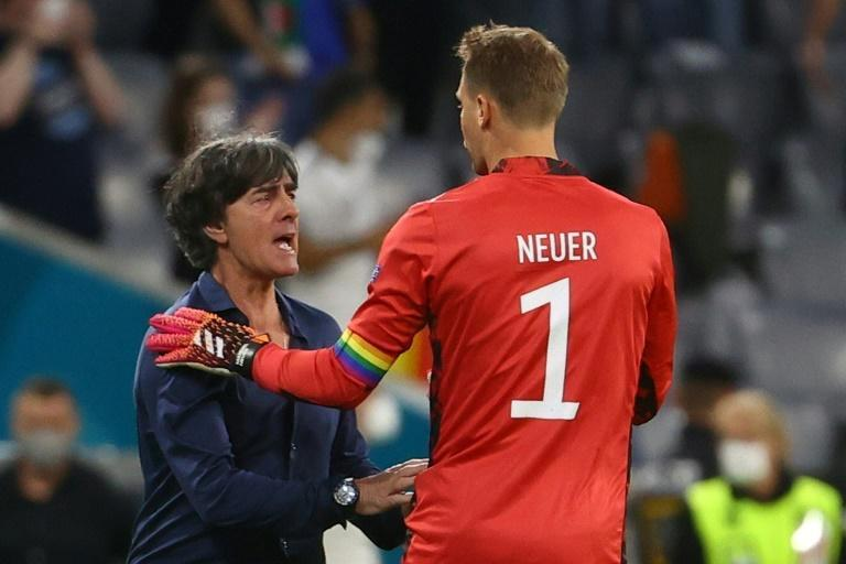 Germany head coach Joachim Loew celebrates with goalkeeper Manuel Neuer after reaching the last 16 of Euro 2020 with a 2-2 draw against Hungary