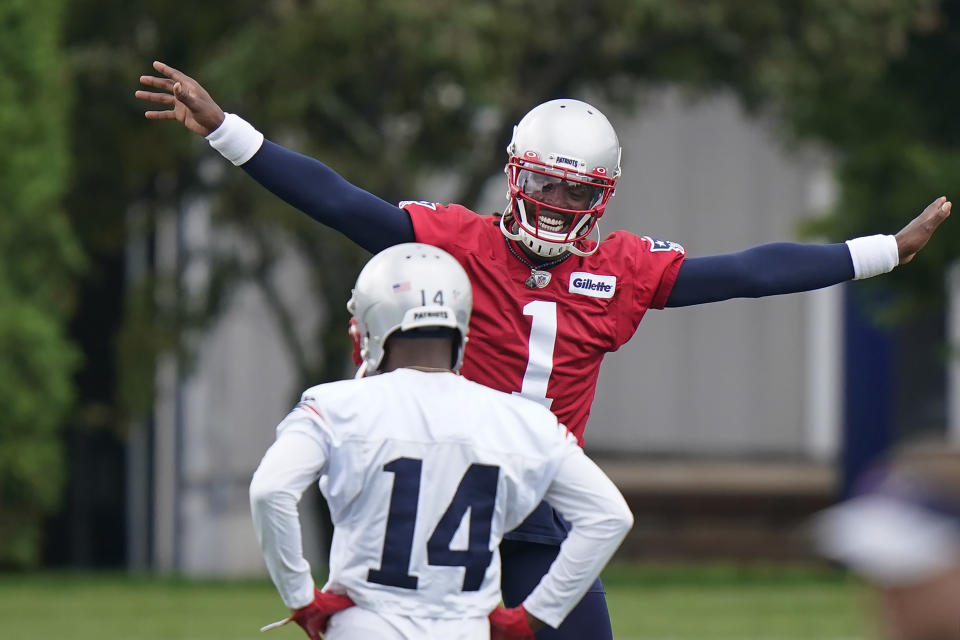 New England Patriots quarterback Cam Newton (1) waves his arms while warming up near wide receiver Marvin Hall (14) during an NFL football minicamp practice, Tuesday, June 15, 2021, in Foxborough, Mass. (AP Photo/Steven Senne)