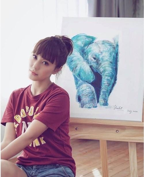 Annie showing off her painting skills
