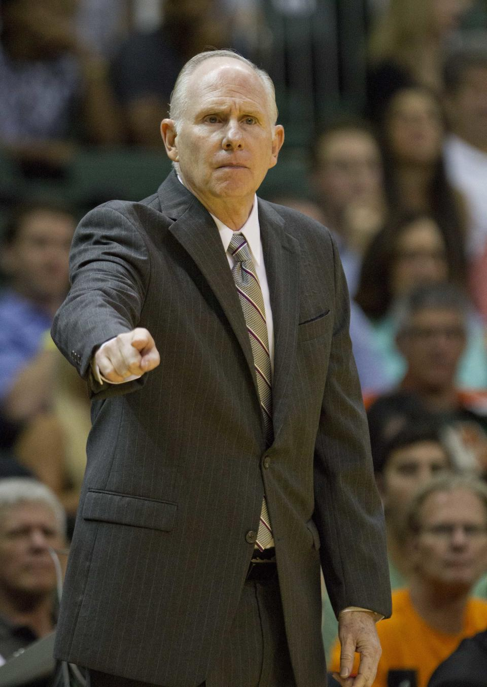 Miami head coach Jim Larranaga gestures to players during the first half of an NCAA college basketball game against Illinois, Tuesday, Dec. 2, 2014 in Coral Gables, Fla. (AP Photo/Wilfredo Lee)