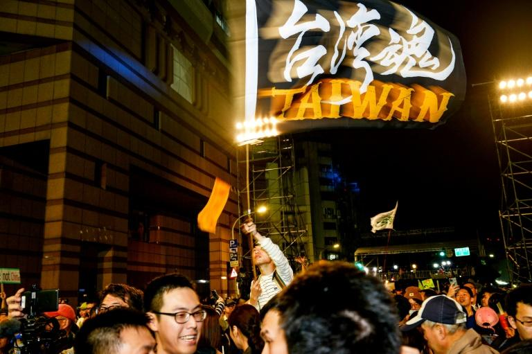 Tsai Ing-wen supporters celebrate her victory and chant slogans in support of pro-democracy protesters in Hong Kong outside the Democratic Progressive Party's headquarters in Taipei