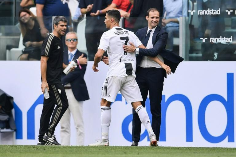 """""""Ronaldo's motivation is to win the Ballon d'Or next year with Juventus,"""" said coach Massimiliano Allegri (R)"""