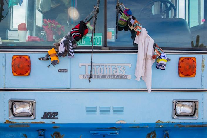 """Paula and Max hang laundry on the bus to dry.<span class=""""copyright"""">Nina Riggio for TIME</span>"""