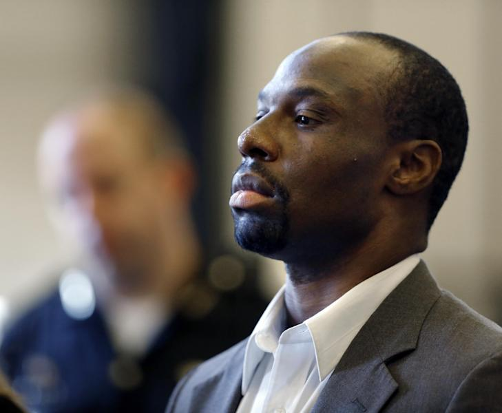 Ricardo Woods stands in front of Judge Beth Myers with his attorney as he is sentenced, Thursday, June 20, 2013 in Cincinnati. Ricardo Woods, 35, was sentenced Thursday to 36 years to life in prison for the murder of David Chandler and for felonious assaults and weapons charges. The murder trial drew national attention when the judge allowed jurors to see a police interview of Chandler two weeks before his death during which he blinked in response to questions about who shot him. (AP Photo/The Cincinnati Enquirer, Carrie Cochran) MANDATORY CREDIT; NO SALES