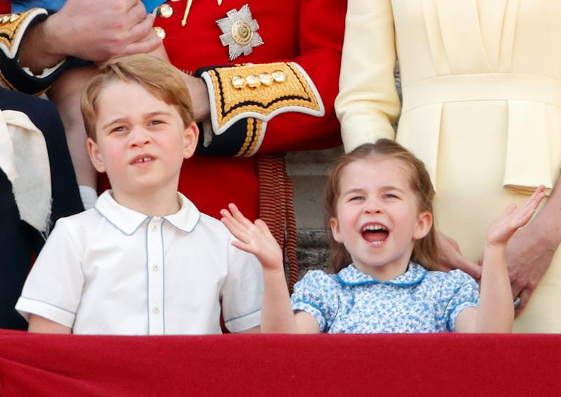 LONDON, UNITED KINGDOM - JUNE 08: (EMBARGOED FOR PUBLICATION IN UK NEWSPAPERS UNTIL 24 HOURS AFTER CREATE DATE AND TIME) Prince George of Cambridge and Princess Charlotte of Cambridge watch a flypast from the balcony of Buckingham Palace during Trooping The Colour, the Queen's annual birthday parade, on June 8, 2019 in London, England. The annual ceremony involving over 1400 guardsmen and cavalry, is believed to have first been performed during the reign of King Charles II. The parade marks the official birthday of the Sovereign, although the Queen's actual birthday is on April 21st. (Photo by Max Mumby/Indigo/Getty Images)