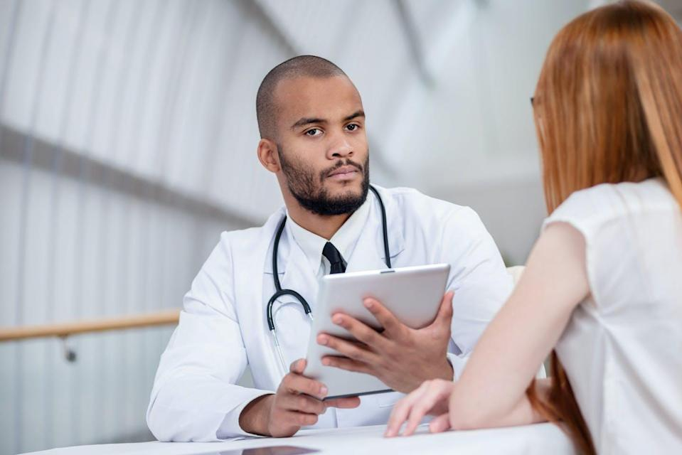 A doctor consulting with a patient.