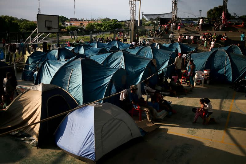 FILE PHOTO: Venezuelan migrants are seen at a coliseum where a temporary camp has been set up, after fleeing their country due to military operations, according to the Colombian migration agency, in Arauquita