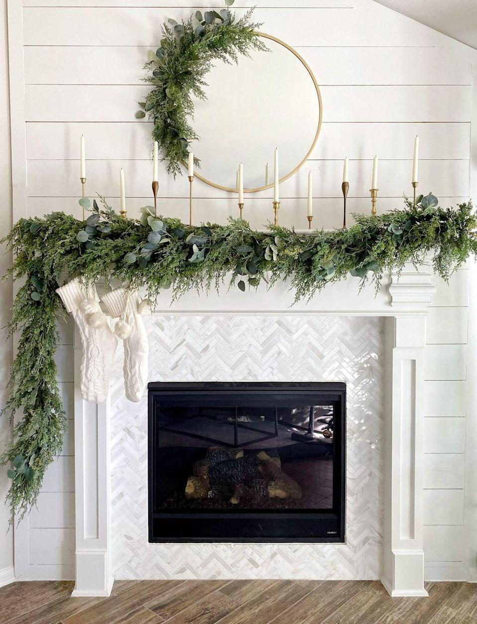 "<p>Rather than center everything on your mantel, let garland or greenery cascade to a single side for a romantic look you'll never want to part with. This works well if you have a TV over your fireplace.</p><p><em>See more at <a href=""https://www.instagram.com/p/B5_oecJncvb/"" rel=""nofollow noopener"" target=""_blank"" data-ylk=""slk:Love Resides Here"" class=""link rapid-noclick-resp"">Love Resides Here</a>. </em></p><p><a class=""link rapid-noclick-resp"" href=""https://www.amazon.com/STAR-Candlestick-Decorative-Candlelight-Ornaments/dp/B07H4CS831?tag=syn-yahoo-20&ascsubtag=%5Bartid%7C10072.g.34484299%5Bsrc%7Cyahoo-us"" rel=""nofollow noopener"" target=""_blank"" data-ylk=""slk:SHOP CANDLESTICKS"">SHOP CANDLESTICKS</a></p>"