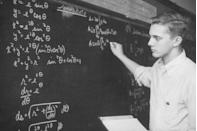 <p>A high school student works out a calculus equation on the chalkboard. </p>