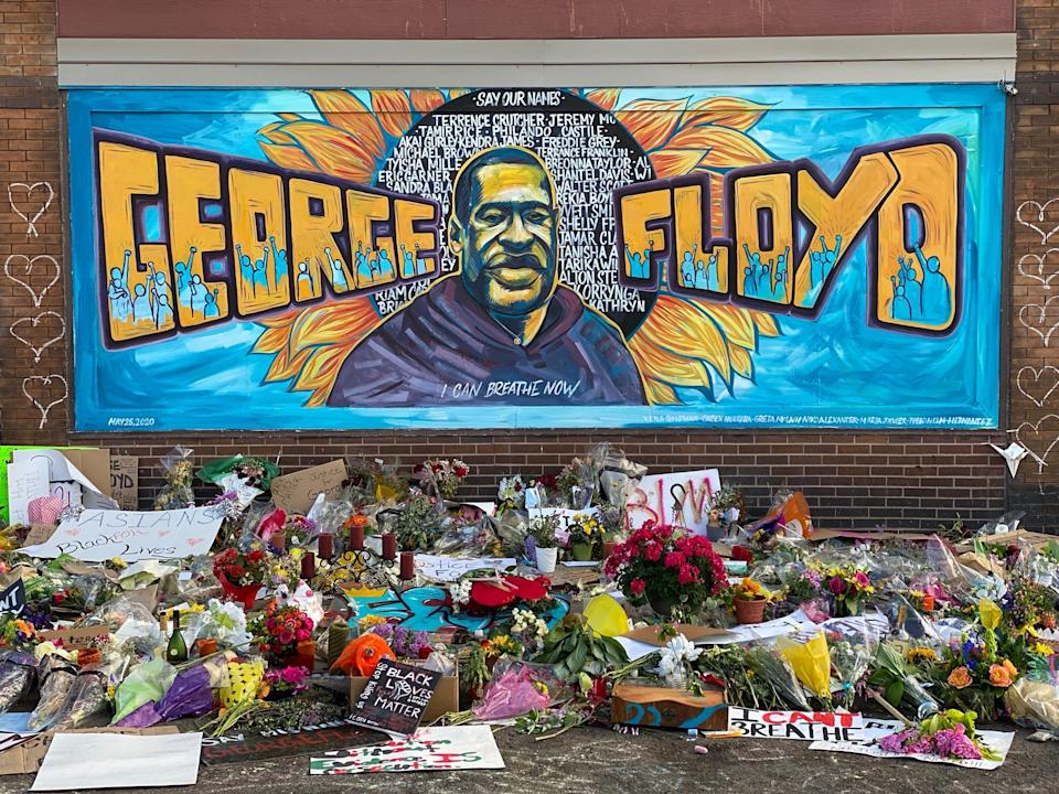 A makeshift memorial for George Floyd including a mural cards and flowers on June 1, 2020 his seen near the spot where he died while in police custody in Minneapolis, Minn.