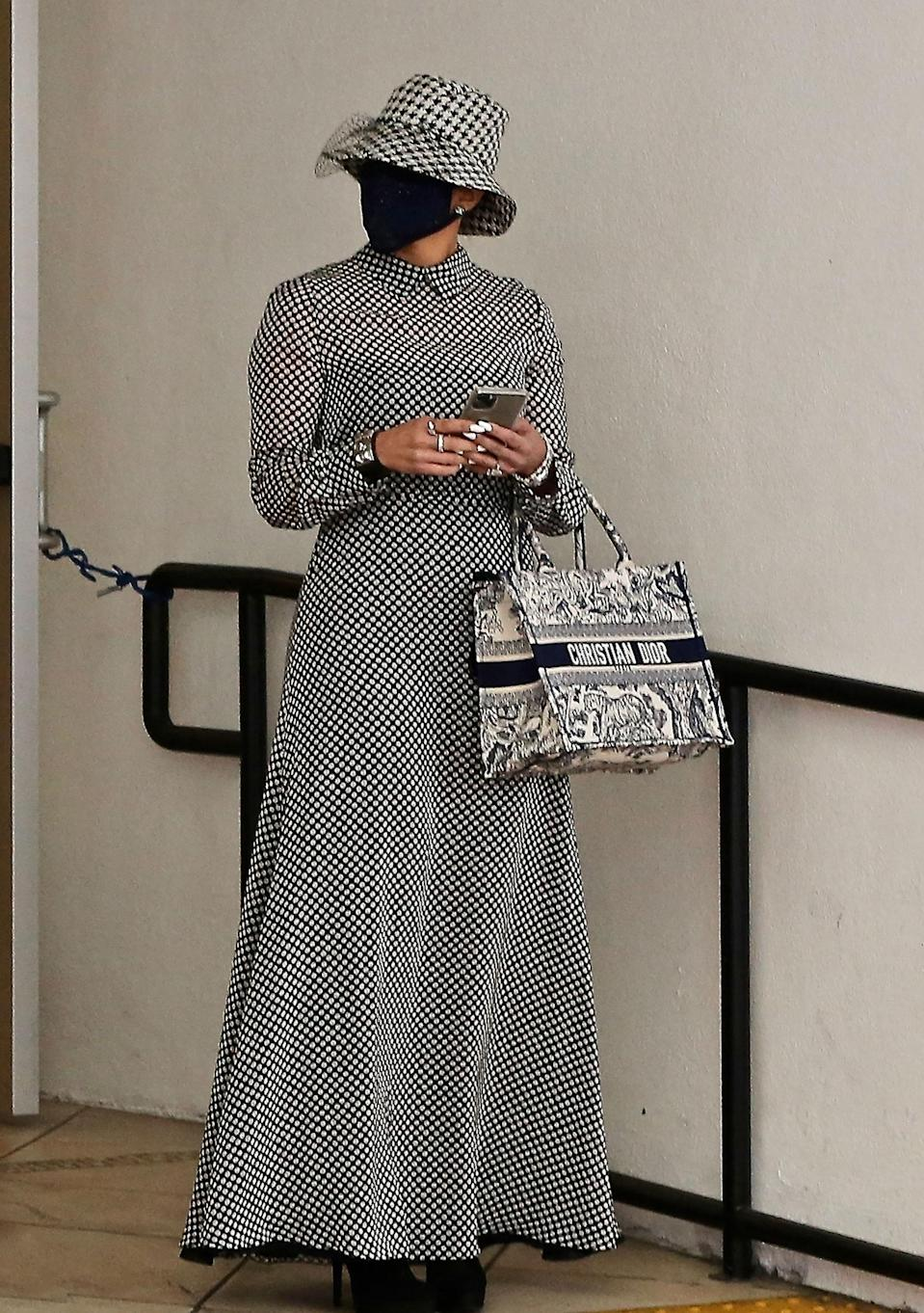 WHO: Jennifer Lopez WHAT: Dior hat, dress, and bag, MasQd facial covering WHERE: Beverly Hills WHEN: December 17