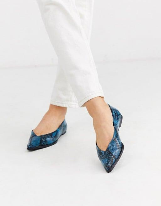 "<p>Navy blue gives these <a href=""https://www.popsugar.com/buy/ASOS-DESIGN-Levels-High-Vamp-Ballet-Flats-537842?p_name=ASOS%20DESIGN%20Levels%20High%20Vamp%20Ballet%20Flats&retailer=asos.com&pid=537842&price=32&evar1=fab%3Aus&evar9=47081143&evar98=https%3A%2F%2Fwww.popsugar.com%2Ffashion%2Fphoto-gallery%2F47081143%2Fimage%2F47081664%2FASOS-DESIGN-Levels-High-Vamp-Ballet-Flats&list1=shopping%2Cshoes%2Cflats%2Cbest%20of%202020&prop13=api&pdata=1"" rel=""nofollow"" data-shoppable-link=""1"" target=""_blank"" class=""ga-track"" data-ga-category=""Related"" data-ga-label=""https://www.asos.com/us/asos-design/asos-design-levels-high-vamp-ballet-flats-in-navy-snake/prd/13334010?clr=navy-snake&amp;colourWayId=16537702&amp;SearchQuery=&amp;cid=6459"" data-ga-action=""In-Line Links"">ASOS DESIGN Levels High Vamp Ballet Flats</a> ($32) a fresh update.</p>"