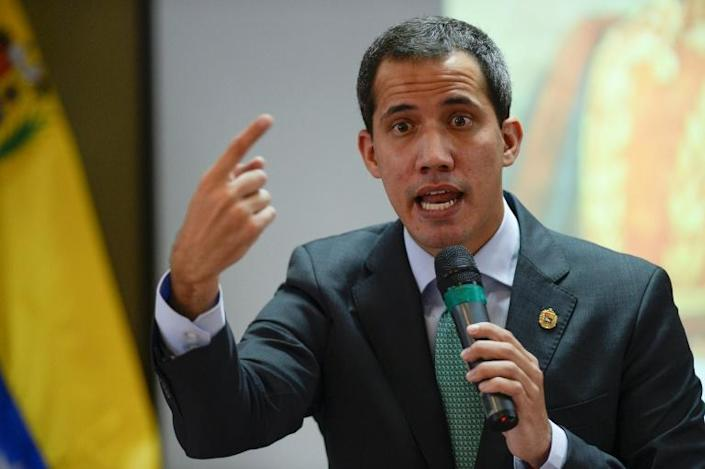 Juan Guaido, the National Assembly speaker recognized as Venezuela's interim president by more than 50 countries, is being investigated for negotiating to drop Caracas' territorial claim on Guyana (AFP Photo/Matias Delacroix)