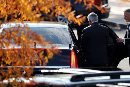 A security agent (R) holds the car door as U.S. Secretary of State Rex Tillerson departs after meetings with President Donald Trump at the White House in Washington, U.S. November 30, 2017. REUTERS/Jonathan Ernst