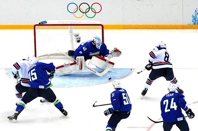 SOCHI, RUSSIA - FEBRUARY 16: Phil Kessel #81 of the United States scores in the first period against Luka Gracnar #40 Slovenia during the Men's Ice Hockey Preliminary Round Group A game on day nine of the Sochi 2014 Winter Olympics at Shayba Arena on February 16, 2014 in Sochi, Russia. (Photo by Martin Rose/Getty Images)