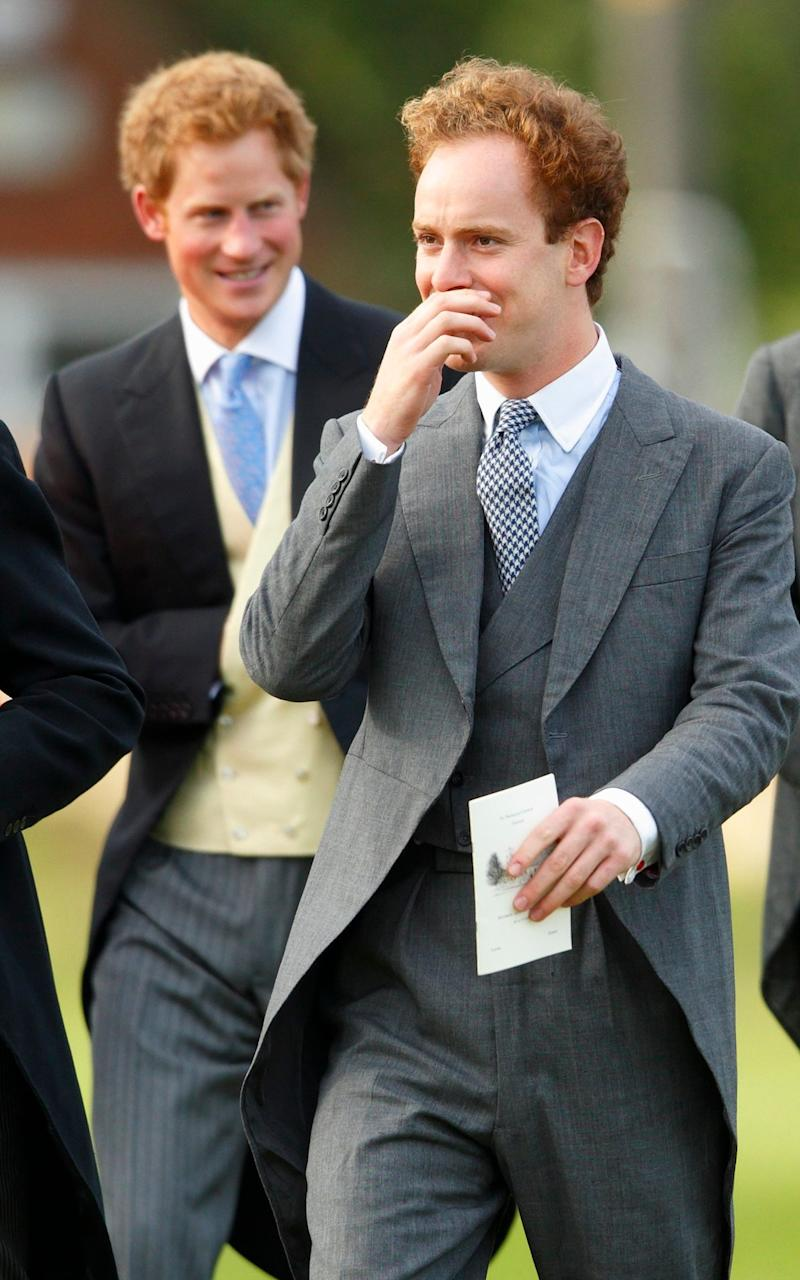 Prince Harry and Tom Inskip attend the wedding of James Meade and Lady Laura Marsham at the Parish Church of St. Nicholas in Gayton on September 14, 2013 near King's Lynn, - Max Mumby/Indigo