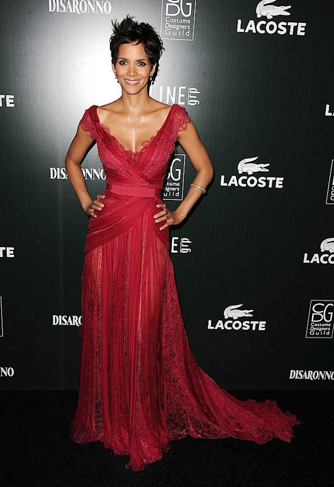 "Halle Berry -- who looks flawless for 44 -- wowed the crowd upon arriving at the 13th Annual Costume Designers Guild Awards at The Beverly Hilton hotel in a cheerful, crimson-colored Elie Saab Spring 2011 Couture gown and diamond bracelet. Steve Granitz/<a href=""http://www.wireimage.com"" target=""new"">WireImage.com</a> - February 22, 2011"