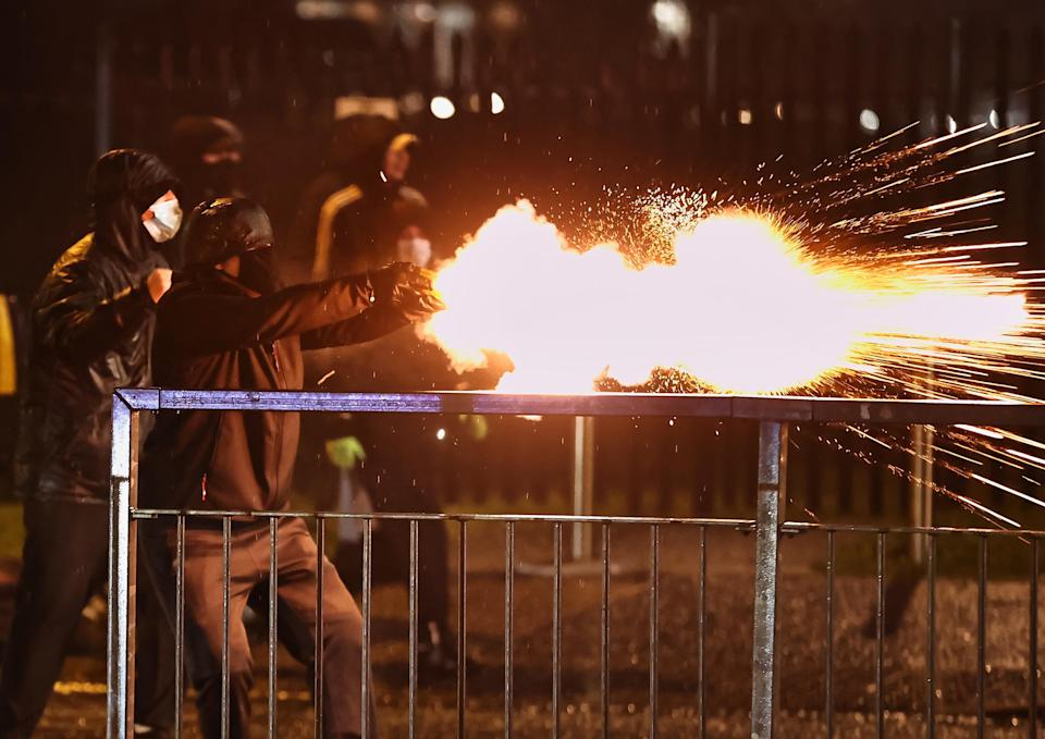 Youths discharge fireworks at the PSNI on the Springfield RoadPA Wire