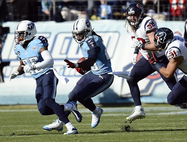 Tennessee Titans running back Chris Johnson (28) follows the blocking of Nate Washington (85) as he carries the ball against Houston Texans defenders Brooks Reed (58) and Shiloh Keo (31) in the second quarter of an NFL football game Sunday, Dec. 29, 2013, in Nashville, Tenn. Johnson passed 1,000 yards rushing for the season on the play. (AP Photo/Mark Zaleski)