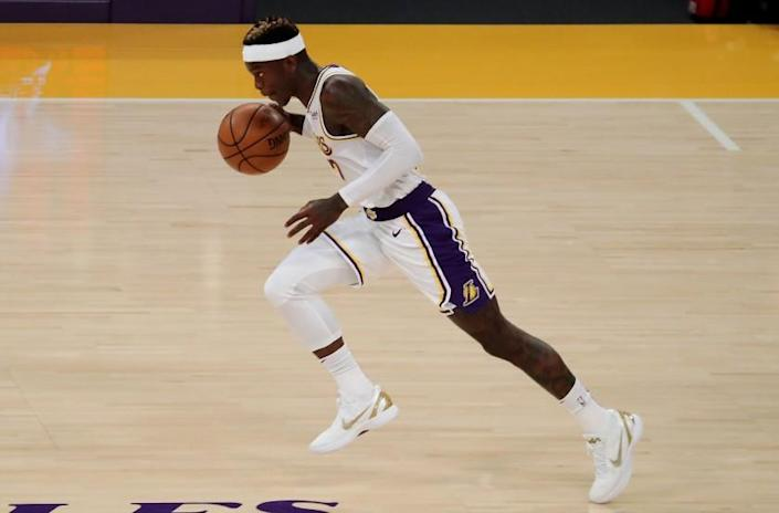 LOS ANGELES, CALIF. - FEB. 28, 2021. Lakers guard Dennis Schroder pushes the ball upcourt against the Warriors during Sunday night's game, Feb. 28, 2020, at Staples Center in Los Angeles. (Luis Sinco/Los Angeles Times)