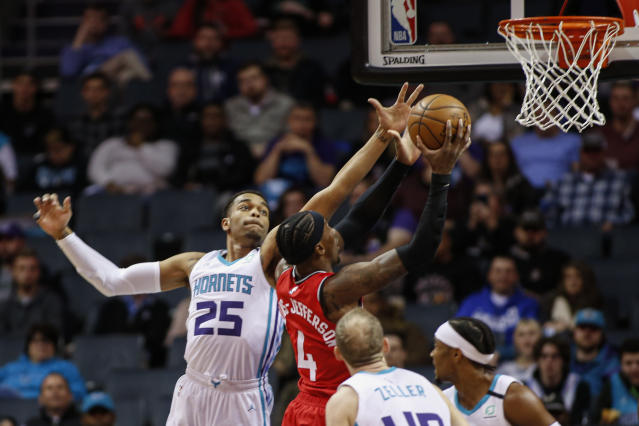 Toronto Raptors forward Rondae Hollis-Jefferson (4) drives to the basket past Charlotte Hornets forward P.J. Washington (25) during the first half of an NBA basketball game in Charlotte, N.C., Wednesday, Jan. 8, 2020. (AP Photo/Nell Redmond)
