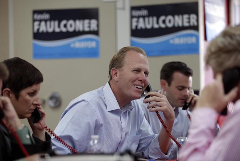 San Diego city councilman and Republican candidate for mayor, Kevin Faulconer smiles as he makes phone calls to voters during mayoral elections Tuesday, Nov. 19, 2013, in San Diego. San Diegans headed to the polls Tuesday to choose a new mayor, after Bob Filner's resignation amid allegations of sexual harassment has left the city with an interim mayor. (AP Photo/Gregory Bull)