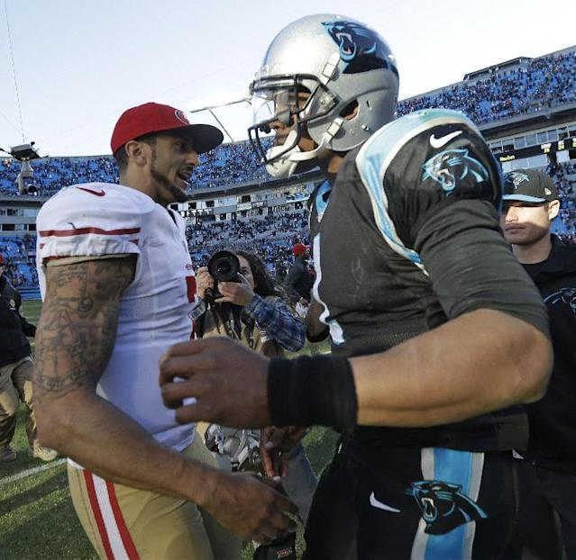San Francisco 49ers quarterback Colin Kaepernick, left, greets Carolina Panthers quarterback Cam Newton after the second half of a divisional playoff NFL football game, Sunday, Jan. 12, 2014, in Charlotte, N.C. The San Francisco 49ers won 23-10. (AP Photo/Gerry Broome)