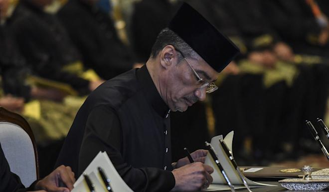 Hishammuddin Hussein signing his letter of appointment as Malaysia's new foreign minister earlier this month. Photo: EPA