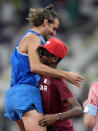 Gianmarco Tamberi, of Italy celebrates with Mutaz Barshim of Qatar after they won joint gold in the final of the men's high jump at the 2020 Summer Olympics, Sunday, Aug. 1, 2021, in Tokyo, Japan. (AP Photo/Martin Meissner)