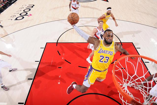 LeBron James slams it home Thursday night in his Lakers debut against the Trail Blazers. (Getty)