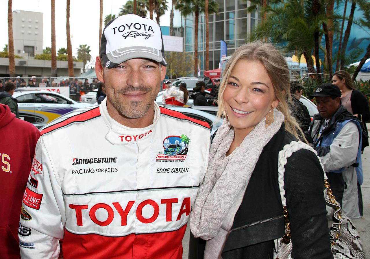 LONG BEACH, CA - APRIL 13: Eddie Cibrian (L) and recording artist LeAnn Rimes attend the 36th Annual Toyota Pro/Celebrity Race Qualifying Day of the Toyota Grand Prix of Long Beach on April 13, 2012 in Long Beach, California.  (Photo by Frederick M. Brown/Getty Images)