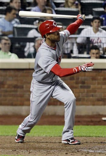 Cincinnati Reds' Wilson Valdez follows through on an RBI single during the ninth inning of a baseball game against the New York Mets Friday, June 15, 2012, in New York. (AP Photo/Frank Franklin II)