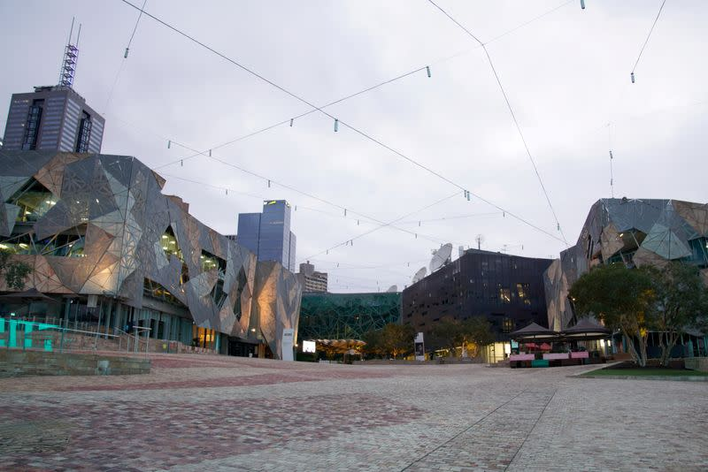 Federation Square is seen devoid of people in Melbourne, Australia, after the city enforced restrictions to curb COVID-19