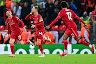 Jordan Henderson (C) celebrates with teammates after scoring his team's third goal during the UEFA Champions League 1st round Group B football match between Liverpool and AC Milan at Anfield in Liverpool, north west England on September 15, 2021. (AFP/Paul ELLIS)
