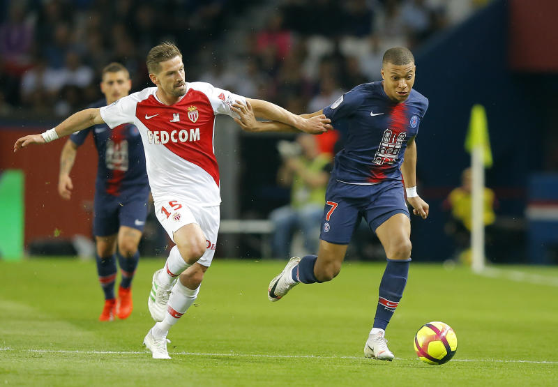 PSG's Kylian Mbappe, right, is challenged by Monaco's Adrien Silva during the French League One soccer match between Paris-Saint-Germain and Monaco at the Parc des Princes stadium in Paris, Sunday April 21, 2019. (AP Photo/Michel Euler)